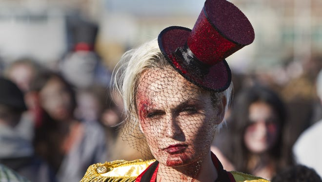 Kristy Allen of Red Bank, with her top hat at a rakish angle, makes for a jaunty zombie in 2015.