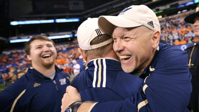 FILE – Chris Coll (right) celebrating Tri-West's 2014 Class 3A state title, is taking over Franklin's program.