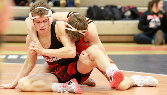 Brighton's Lee Grabowski (back) beat Pinckney's Jimmy Muscato for a second time at districts on Thursday night. Brighton won the district title with a 68-3 win over Pinckney.
