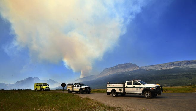 Wildland firefighters head into Glacier National Park to battle the Reynolds Creek fire on July 23, 2015.