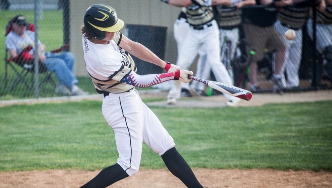 Daleville's Ryan Hale, shown here hitting a home run against Wes-Del last season, hit one of the Broncos' four home runs against Delta on Thursday.
