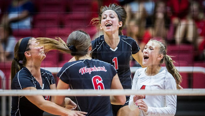 Wapahani celebrates a point during a five-set win over Delta at Worthen Arena  Tuesday, Aug. 15, 2017.