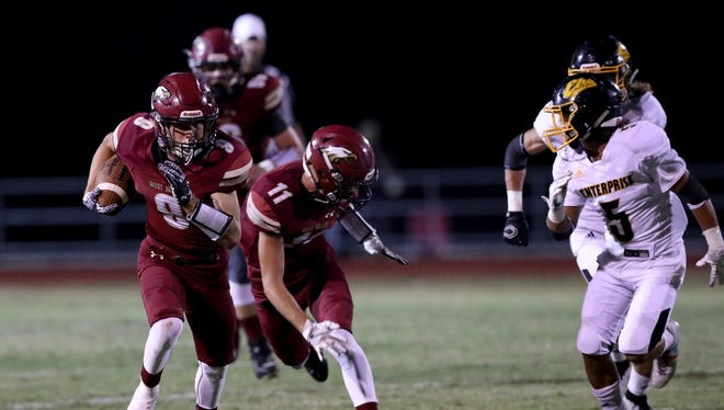 West Valley's Dylan Moore (left, carrying ball) rushes against Enterprise in September 2017.