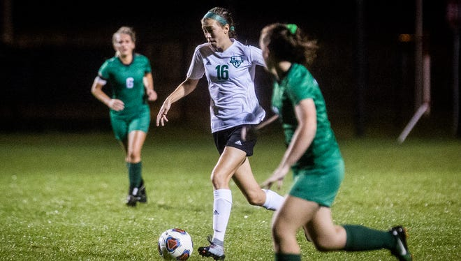 Yorktown's Lea Alexander dribbles through the New Castle defense in the sectional championship last season. Alexander and the Tigers won another sectional title on Saturday.
