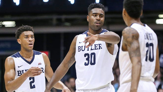 Butler Bulldogs guard Aaron Thompson (2), Butler Bulldogs forward Kelan Martin (30) and Butler Bulldogs guard Henry Baddley (20) celebrate their lead during first half action between the Butler Bulldogs and the Princeton Tigers at Hinkle Fieldhouse, Indianapolis, Sunday, Nov. 12, 2017. Butler lead at halftime, 41-31.