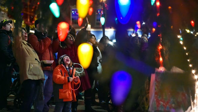 Ryelan Swartz, 6 of West Manchester Township, reacts as the Christmas tree is lit in Continental Square during the expanded, day-long Light Up York festivities Saturday, Dec. 2, 2017, in York. Rather than being held on First Friday evening, as it has in the past, Light Up York was held on Saturday afternoon to encourage families to explore downtown before gathering in Continental Square for the lighting of the Christmas Tree.