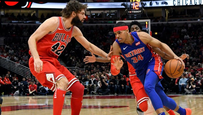 Pistons forward Tobias Harris (34) is defended by Bulls center Robin Lopez (42) during the first half on Saturday, Jan. 13, 2018, in Chicago.