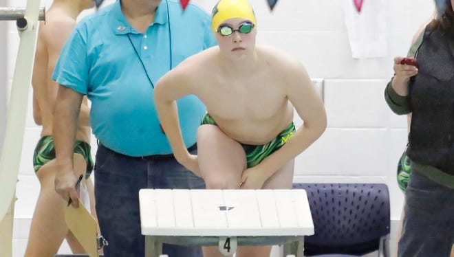 Howell's Hunter Gubeno set a school record in the  200 individual medley and won the 500 freestyle in a 102-84 victory over Brighton.