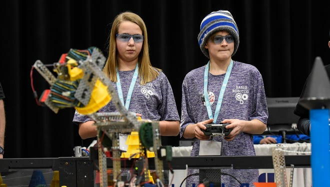 Molly Stein and Dominic Larson of Team Giggagears, Sartell, compete in the VEX Robotics State Championship Saturday, Feb. 3, at the River's Edge Convention Center.