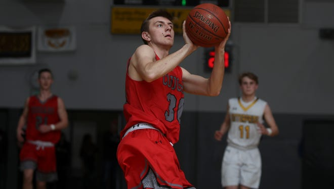 Foothill's Matthew Gamble goes up for a shot Friday during the Cougars' 61-36 win over the Hornets.