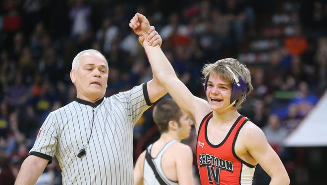 Norwich's Dante Geislinger wins the 99-pound Division II NYSPHSAA Wrestling title at Times Union Center in Albany on Saturday. Geislinger defeated Camden's Devin Coleman, 9-4 in the final.