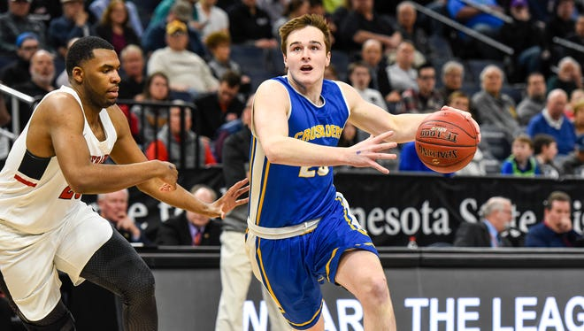 St. Cloud Cathedral's Michael  Schaefer goes in to shoot against Minnehaha Academy's during the first half Friday, March 23, in the state Class 2A boys basketball tournament at the Target Center in Minneapolis.
