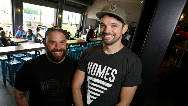 HOMES Brewery head brewer Nick Panchame, left, and owner Tommy Kennedy are pictured May 23, 2018 in the brewery on Jackson Avenue in Ann Arbor, Michigan.