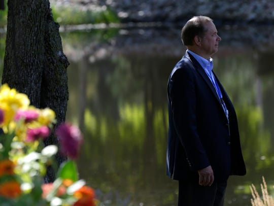 A Sentry Insurance employee stands near the ponds at