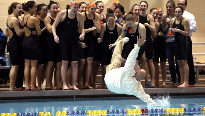 Mountain Lakes head coach Dave Leshnower takes a leap into the pool after the Lakers won the NJSIAA Public C girls swimming final vs. Haddonfield at the College of New Jersey. February 20, 2016. Ewing Twp., N.J.