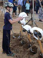 Daniel Phelka, 5, checks out the shovels and construction helmets at the May 7 groundbreaking ceremony for South Lyon's William A. Pearson Elementary School.