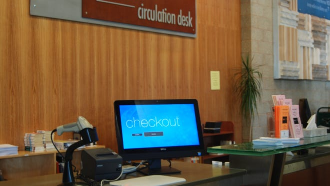 The Cedar City Library in the Park implemented two self-checkout machines Monday.