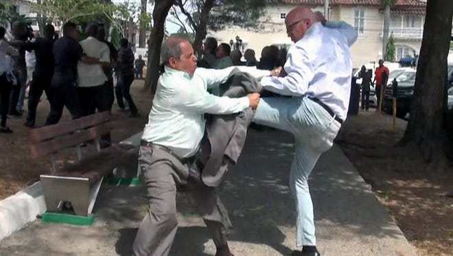 Photo released by La Estrella de Panama shows Cuba demonstrators fighting outside the Cuban Embassy in Panama City on April 8, 2015, before the Summit of the Americas begins.
