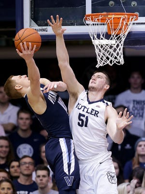 Butler Bulldogs center Nate Fowler (51) attempts to blocks the shot by Villanova Wildcats guard Donte DiVincenzo (10) in the first half of their game Wednesday, January 4, 2017, evening at Hinkle Fieldhouse.