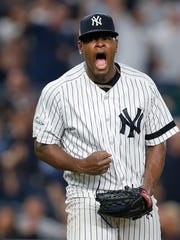 New York Yankees pitcher Luis Severino reacts after