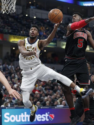 Indiana Pacers forward Thaddeus Young (21) puts up a shot over Chicago Bulls forward Bobby Portis (5) in the first half of their game at Bankers Life Fieldhouse Wednesday, Dec 6, 2017.