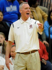 Henderson County's head coach Jeff Haile yells down