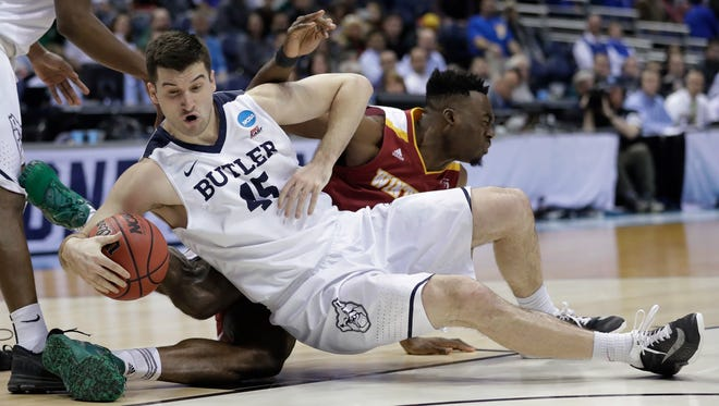 Butler's Andrew Chrabascz (45) collides with Winthrop's Duby Okeke during the second half of an NCAA first-round game Thursday, March 16, 2017, in Milwaukee.