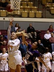 Midwestern State's Courtney Kerr puts up a layup by