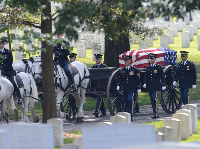 A horse-drawn caisson carries the casket of U.S. Army Maj. Gen. Harold J. Greene during his funeral service at Arlington National Cemetery.