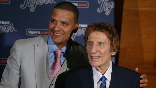 Victor Martinez, left, poses with Detroit Tigers owner Michael Ilitch on Nov. 14, 2014, at Comerica Park in Detroit.