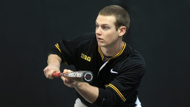 Iowa's Eric Toole practices during media day at Iowa's indoor practice facility on Tuesday, Feb. 3, 2015.  David Scrivner / Iowa City Press-Citizen