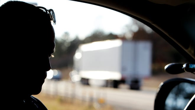 Sgt. Brett Black of the Michigan State Police Commercial Vehicle Enforcement Division watches interstate traffic on I-94 near Jackson on Nov. 4, 2015.  He is an 18-year veteran of the department.  The former U.S. Marine also teaches at the MSP Academy and to other law enforcement agencies nationwide.
