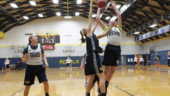 Regina teammates run drills during practice on Wednesday, Nov. 18, 2015.