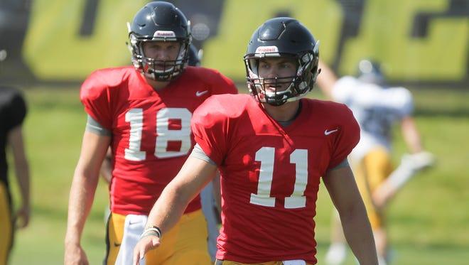 Iowa freshman quarterbacks Ryan Boyle (11) and Drew Cook (18) stretch during practice on Wednesday, Aug. 12, 2015.   David Scrivner / Iowa City Press-Citizen