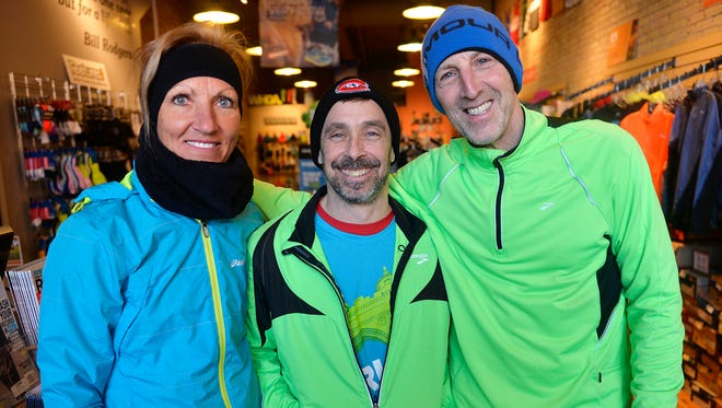 St. Cloud River Runners member from left: Cindy Lewandowski, George Bienusa and Monte Steffens gather for a photo Feb. 3, 2016, at the Endurunce Shop in downtown St. Cloud. Bienusa will be running a marathon in the last of all 50 states, Florida, on Feb. 14. Steffens and Lewandowski, who have already run marathons in all 50 states, plan to go along to run with him and celebrate.