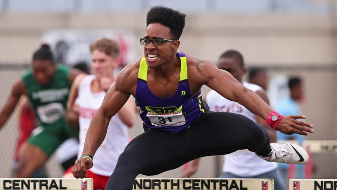 Ben Davis senior Chris Evans competes in the 110 meter hurdles during a Marion County boys track meet at North Central High School, Indianapolis, Wednesday, May 11, 2016.