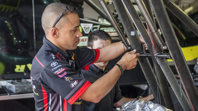 Dragster driver J.R. Todd prepared for qualifications Saturday at Lucas Oil Raceway in Brownsburg, Ind.