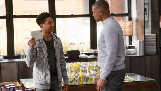 Howard (Will Smith, right) is visited by Time (Jacob Latimore) in emotional holiday drama 'Collateral Beauty.'