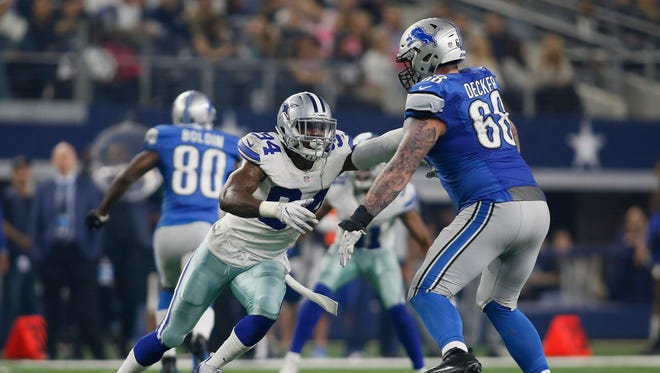 Dec 26, 2016; Arlington, TX, USA; Lions offensive tackle Taylor Decker  blocks the Cowboys' Randy Gregory in the fourth quarter at AT&T Stadium.