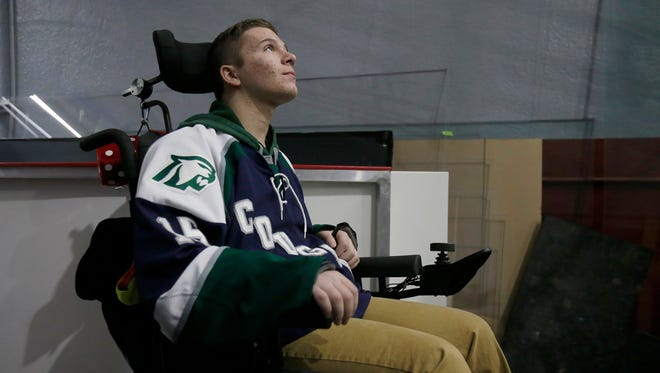 Anthony Mastronardi, waits to make his way onto the ice during a fundraising event for Mastronardi, at Fraser Hockeyland on Sunday, April 30, 2017 in Fraser. Mastronardi suffered a severe spinal cord injury during a high school hockey game this past December.