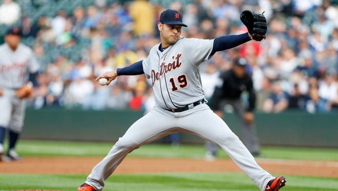 Tigers pitcher Anibal Sanchez (19) throws during the first inning Monday in Seattle.