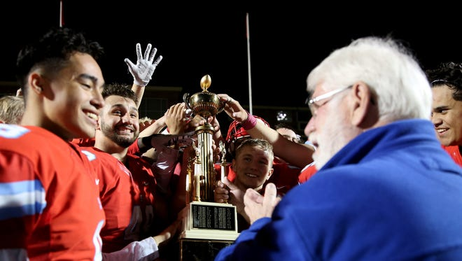 South Salem accepts the Mayor's Trophy from Mayor Chuck Bennett following the North Salem vs. South Salem football game at South Salem High School in Salem on Friday, Oct. 6, 2017. South South won the Mayor's Trophy 24-14.