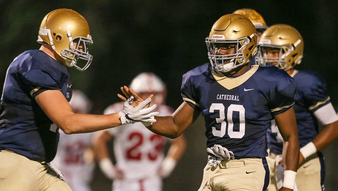 Cathedral running back Markese Stepp (30) is headed to Notre Dame next season.