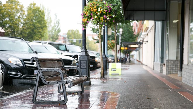 """A bench outside of Olivia's, one of the participating businesses in the """"Go Nuts Downtown"""" scavenger hunt."""