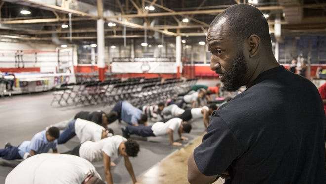 Khali Sweeney, founder and CEO of Downtown Boxing Gym, center, encourages trainees during a training session at the Downtown Boxing Gym in Detroit, Friday, December 8, 2017.