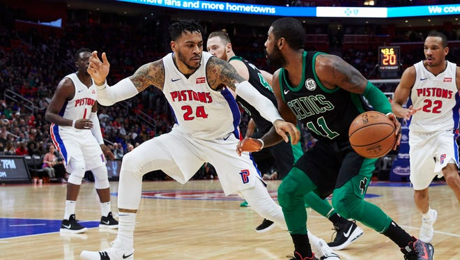 Celtics guard Kyrie Irving dribbles while defended by Pistons forward Eric Moreland in the first half at Little Caesars Arena on Sunday.