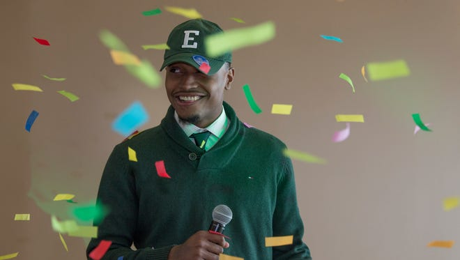 Detroit Cass Tech's Aaron Jackson, who is signing with Eastern Michigan, gets blasted with confetti as he participates during the signing day event on Wednesday, Dec. 20, 2017, at the Horatio Williams Foundation in Detroit.