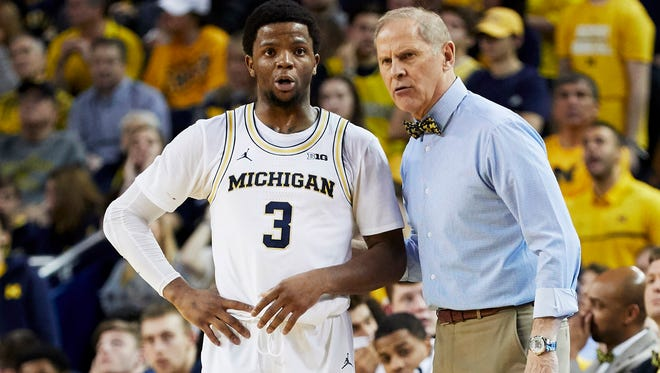 Michigan Wolverines head coach John Beilein talks to guard Zavier Simpson (3) during the second half against the Rutgers Scarlet Knights at Crisler Center.