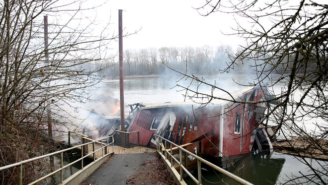 A boathouse burns on the west bank of the Willamette River in Salem on Tuesday, Feb. 20, 2018.