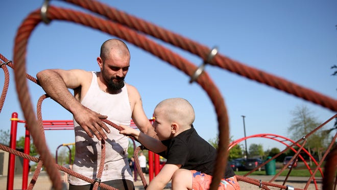 Luke Slaughter, 25, of Salem, plays with his stepson, Jesse Spain, 4, at River Road Park in Keizer on Wednesday, April 25, 2018. Slaughter, a convicted felon who successfully completed a Marion County reentry initiative program in 2014, now lives in an apartment with his wife and their five children.